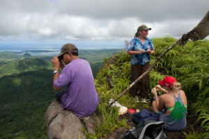 Hikers at the summit of Kupwuriso Mountain, U, Pohnpei, Micronesia